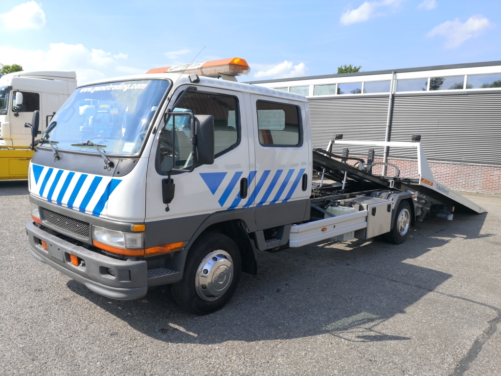 Mitsubishi Canter 7500kg 7 persoons Jige Rollmatic 35